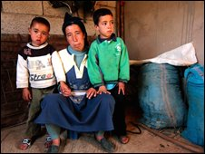 Widow of one of Hansala's dead migrants with her two sons