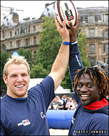 England stars James Haskell and Paul Sackey hold aloft a rugby ball