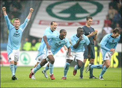 Man City celebrate as they book their place in the draw for the first round
