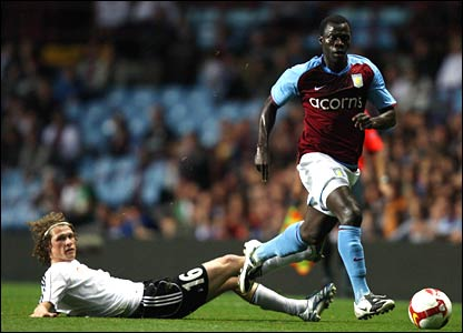 Moustapha Salifou of Villa gets away from his man