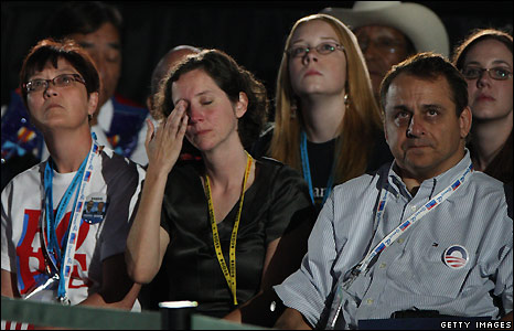 Members of the audience react to Barack Obama's speech