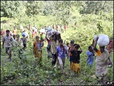 Fleeing villagers in Orissa