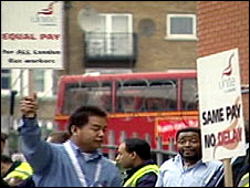 Bus drivers picket a bus garage
