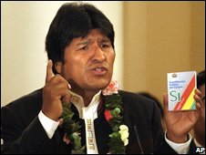 Bolivian President Evo Morales holds a copy of his proposed new constitution, 28 August