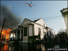 A house burning in the floodwater of New Orleans