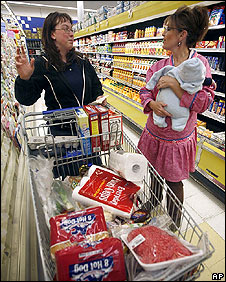 Sarah Palin (right) speaks to a shopper in Barrow, Alaska, 30 June 2008