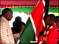 President Mwai Kibaki (l) with one of the athletes