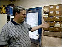 Malcolm Poole looking at order board in his brick cutting company