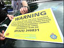 Illegal vehicle waning sticker