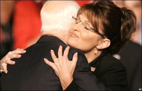 John McCain (L) is hugged by Sarah Palin