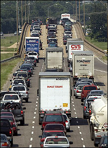 New Orleans residents evacuate west along Interstate 10 on 29 August