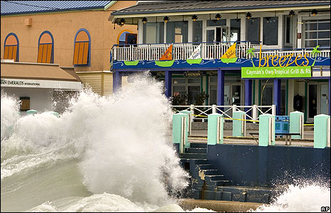 A storm wave breaks against the waterfront in George Town, Grand Cayman Island, on 30 August