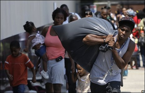 Residents of New Orleans evacuate the city on 30 August.