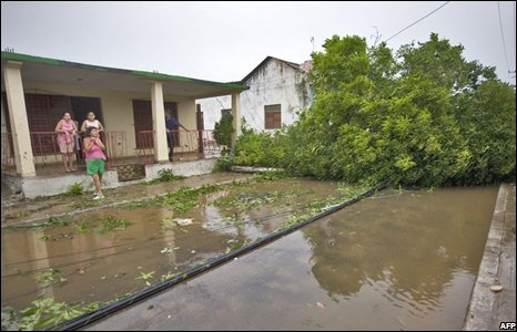 Residents observe a flooded street in Los Palacios city in Pinar del Rio province on 30 August.