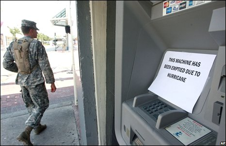 A member of the Louisiana National Guard walks past a cash machine in New Orleans on 30 August.
