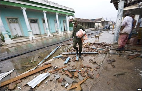 A Cuban walks over debris from destroyed houses, on August 30, 2008 in Los Palacios city in Pinar del Rio province -100 km west of Havana.