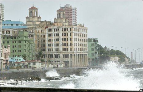 In Havana, heavy winds and rain battered crumbling historic buildings.