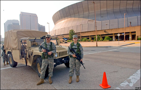 Troops stand guard outside the Superdome in New Orleans