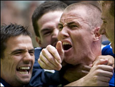 Kenny Miller (right) celebrates after scoring against his former club