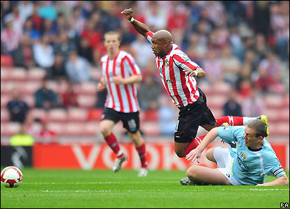 Diouf goes down under pressure from Richard Dunne