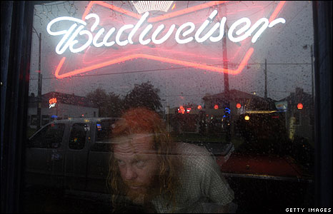 Man looks out of a window of a bar in New Orleans
