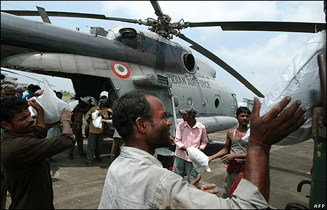 Relief aid is loaded on to a helicopter at Poornia airforce station, north east of Patna