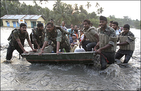 Indian army soldiers rescue flood victims in the village of Puthimari