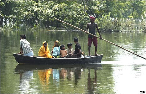 Families are transported through flood waters in Poornia district, Bihar