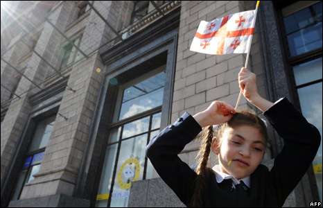 "A girl fixes a Georgian flag in her hair during a rally ""Stop Russia!"" in Kiev on 1 September"