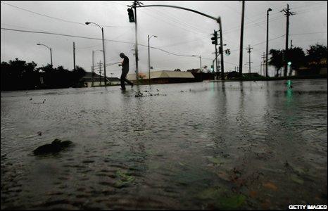 A woman walks through the rain in New Orleans, 01/09