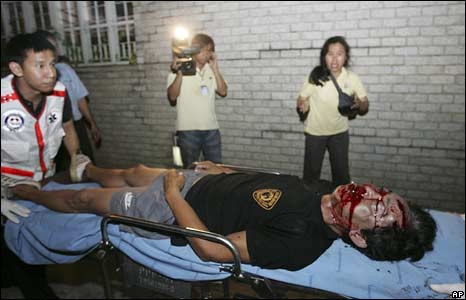Medics carry an injured pro-government supporter to a hospital in Bangkok
