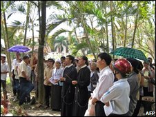 Church leaders and parishioners praying on land they occupied in the Dong Da district, undated file pic