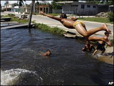 Children play in a flooded canal in Havana, 1 September 2008