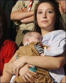 Bristol Palin, 17, holds her brother Trig during a Republican campaign rally in Dayton, Ohio, on 29 August 2008
