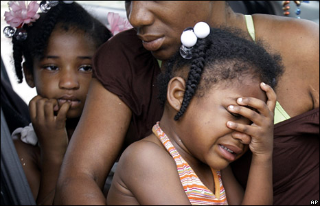 Debra Peterson comforts her granddaughters as they wait in their car to return to New Orleans