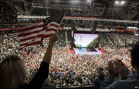 Delegates cheer a speaker.