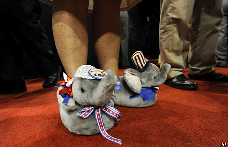 A delegate wears slippers with Republican logos