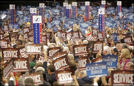 Republican delegates wave signs at the national convention in St Paul, 2 Sept