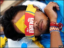 An anti-government protester camped out at Government House takes a nap on 3 September 2008