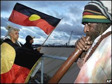 An Aboriginal man plays a didgeridoo (R) during a protest on Cockatoo Island (2000)