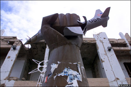 A monument featuring a clenched fist crushing a U.S. fighter aircraft is seen outside the former residence of Libyan leader Muammar Gaddafi,