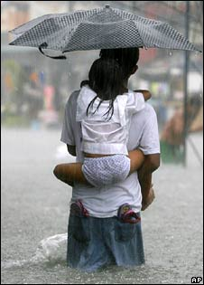 Family in flood from typhoon