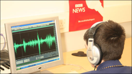 School Reporter looking at audio waves on a screen