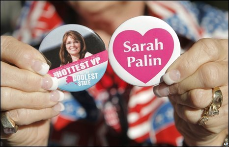 A Republican supporter holds Sarah Palin badges