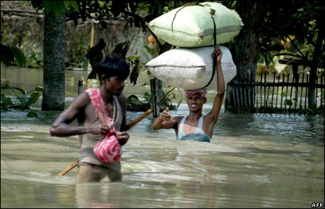 Villagers wade through water in Laxmipur