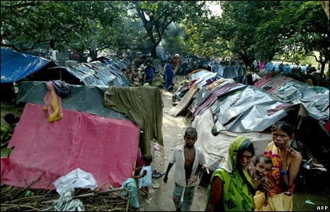 Flood-affected villagers walk through a makeshift relief camp in Banmankhi, some 400kms north-east of capital Patna.