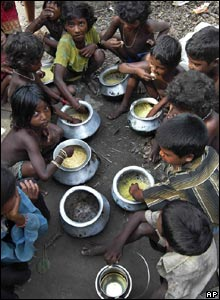 Flood affected children eat food provided by local people in Madhepura district