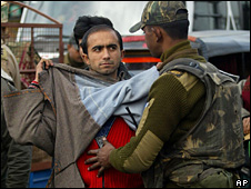 A Srinagar resident being frisked by Indian troops
