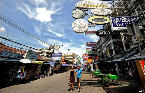 Tourists walk down travellers' hub Khao San road on 4 September 2008