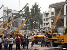 Rescuers work on the recovery at the collapsed Juyuan middle school
